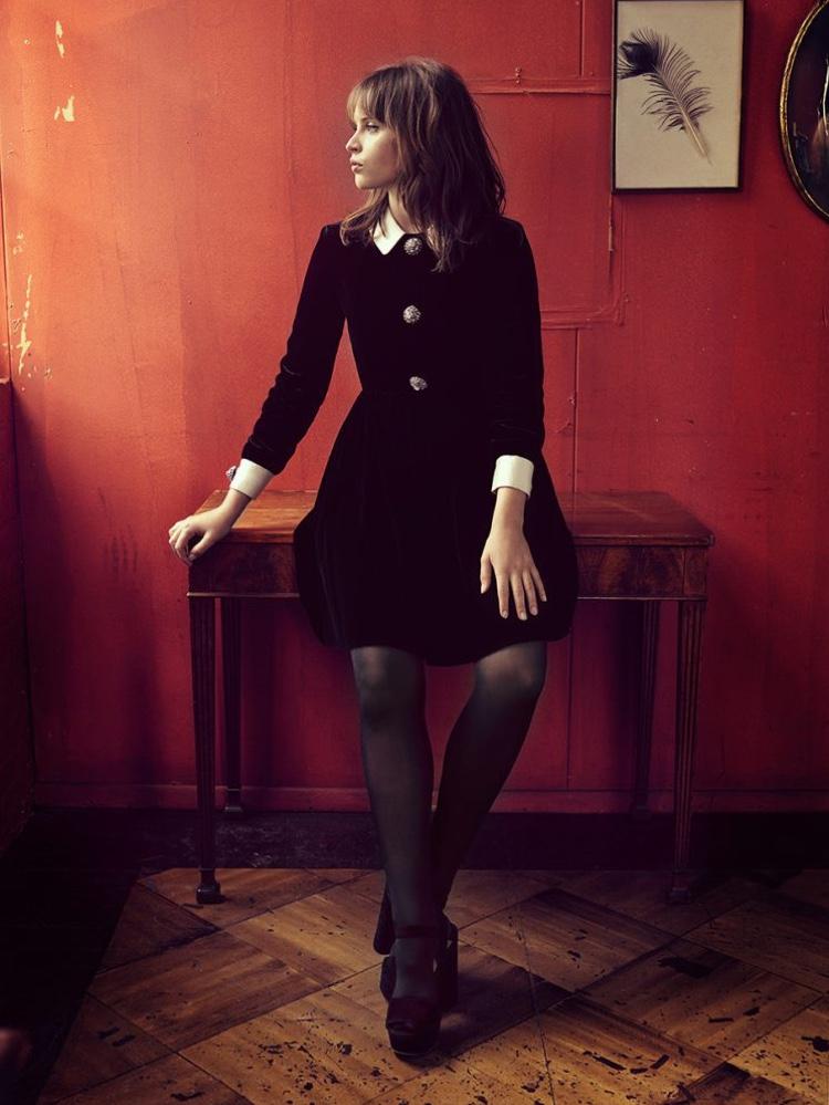 Felicity Jones poses in little black dress with platform heels