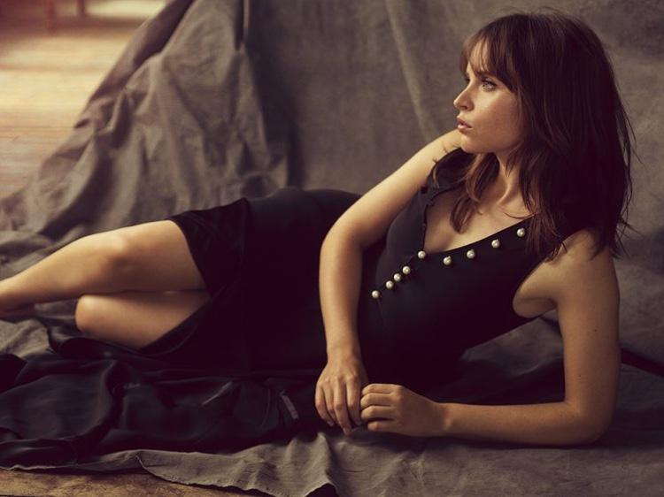Actress Felicity Jones wears embellished little black dress