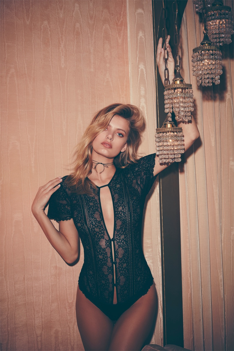 Embracing a form-fitting silhouette, Bregje Heinen models For Love & Lemons Elsa lace bodysuit