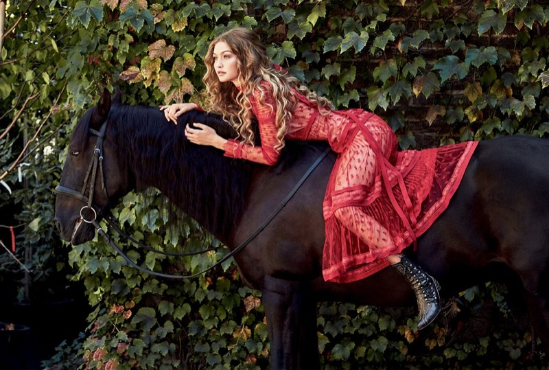 Posing on a horse, Gigi Hadid wears red lace dress from Valentino