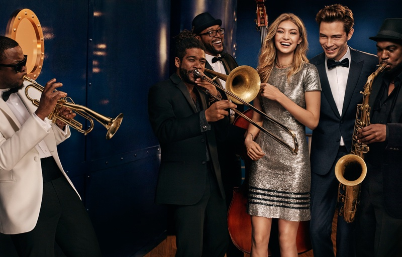 Model Gigi Hadid is joined by a band for Tommy Hilfiger's holiday 2016 advertising campaign