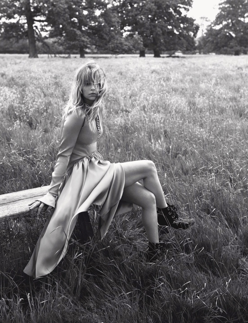 Posing outdoors, Haley Bennett wears Dior dress and boots