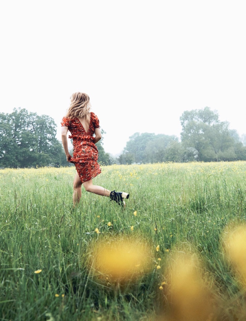 Running through fields, Haley Bennett wears red dress with floral embellishments
