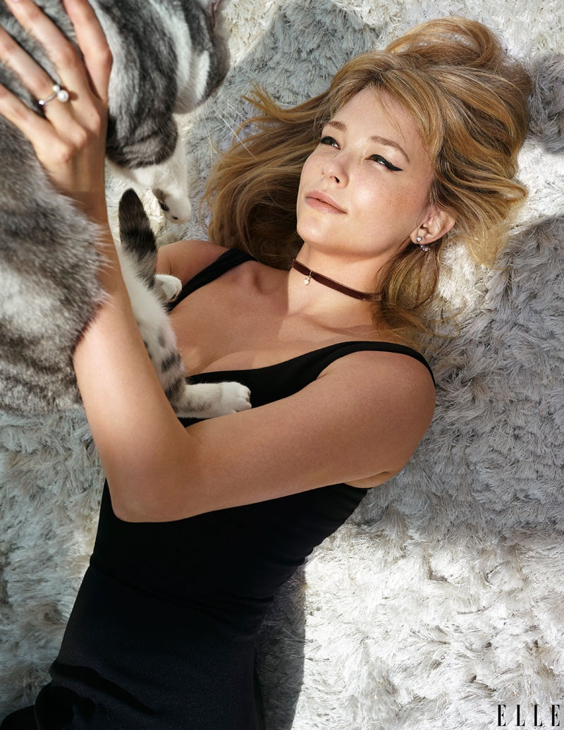 Posing with a dog, Haley Bennett models Prabal Gurung dress