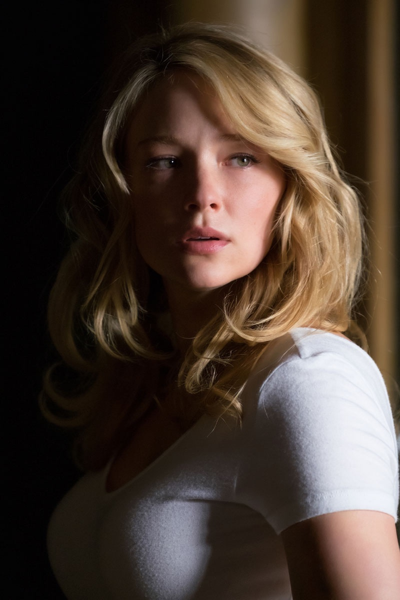 Actress Haley Bennett looks fearful in a still for Girl on the Train