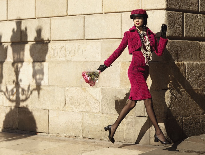 Hanaa Ben Abdesslem wears Chanel jacket and high-waisted skirt