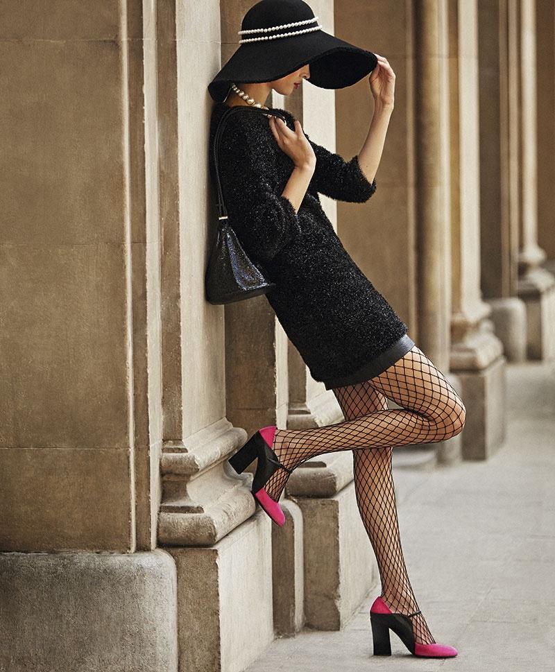 Hanaa Ben Abdesslem wears a black embellished dress with blocked heels