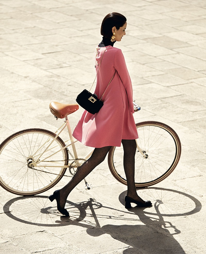 Walking with a bicycle, Hanaa Ben Abdesslem models pink swing dress