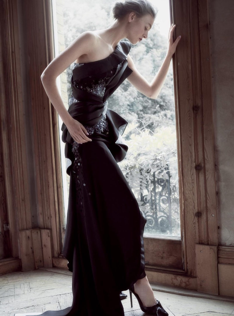 The model wears haute couture looks in the fashion editorial