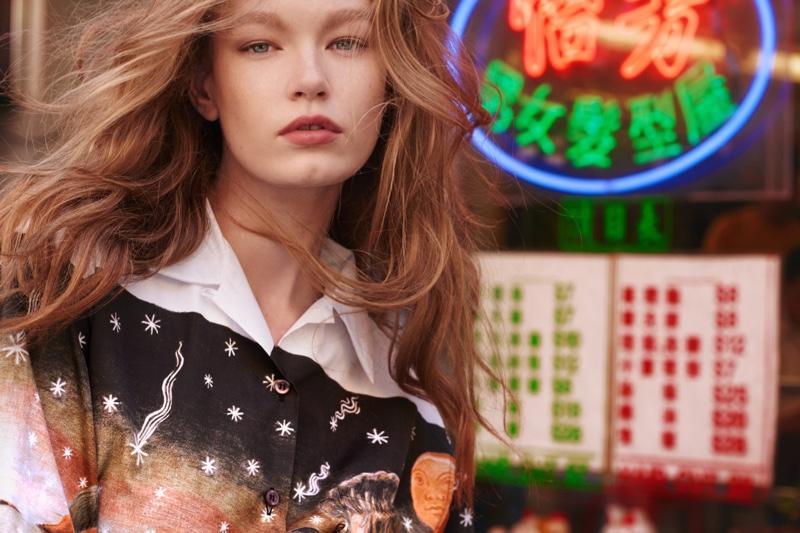 Model Hollie-May Saker poses in Prada printed shirt