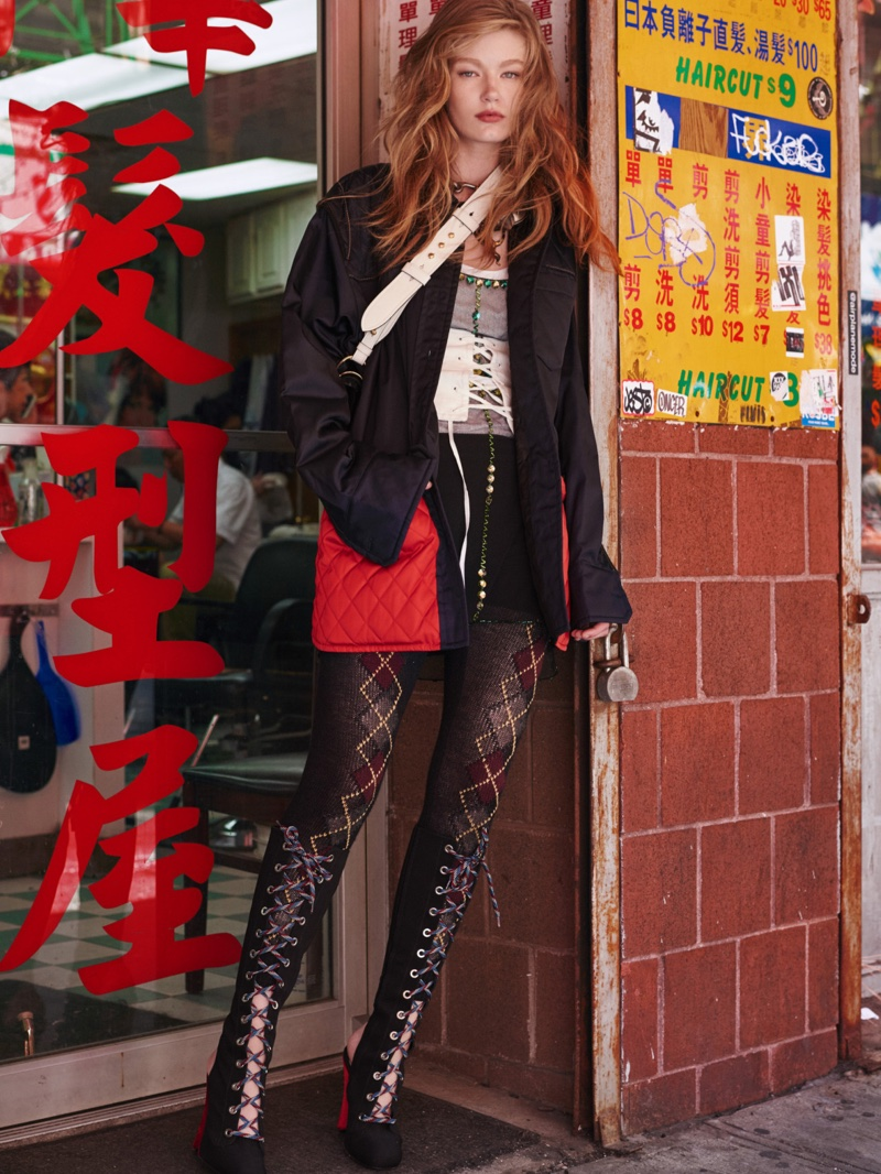 Posing on the city streets, Hollie-May Saker models quilted jacket over corset and diamond print leggings