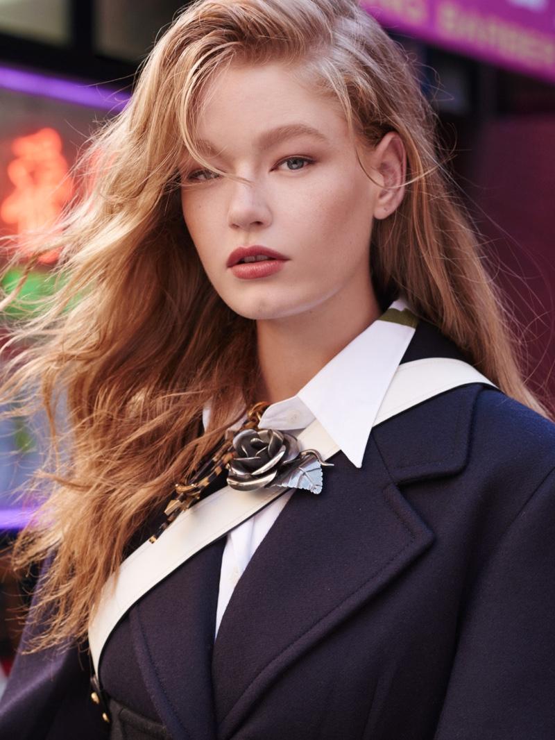 Hollie-May Saker poses in Prada coat and brooch