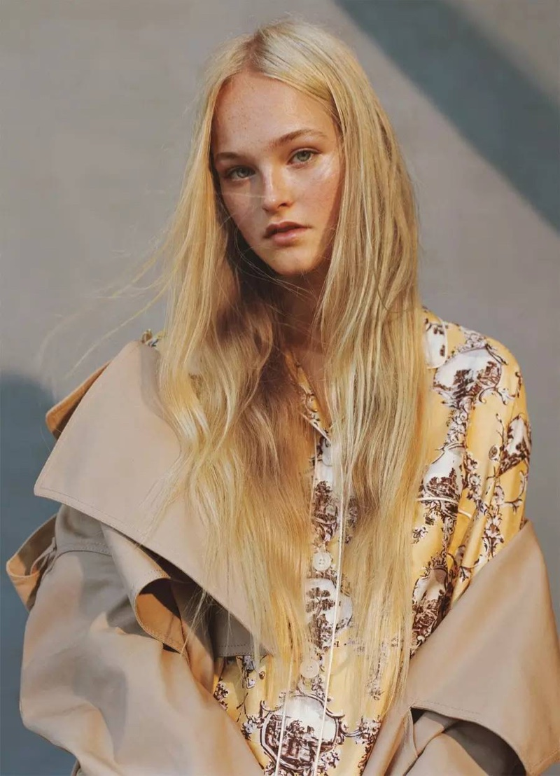 Model Jean Campbell wears Burberry trench coat and printed pajama top