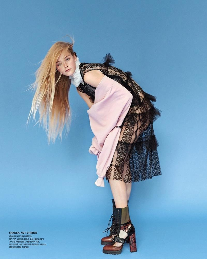 The blonde model layers up in Burberry dress with leather boots