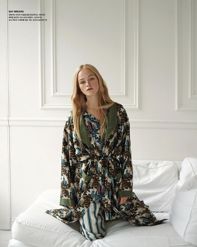 Posing on a bed, Jean Campbell models Burberry pajama inspired separates