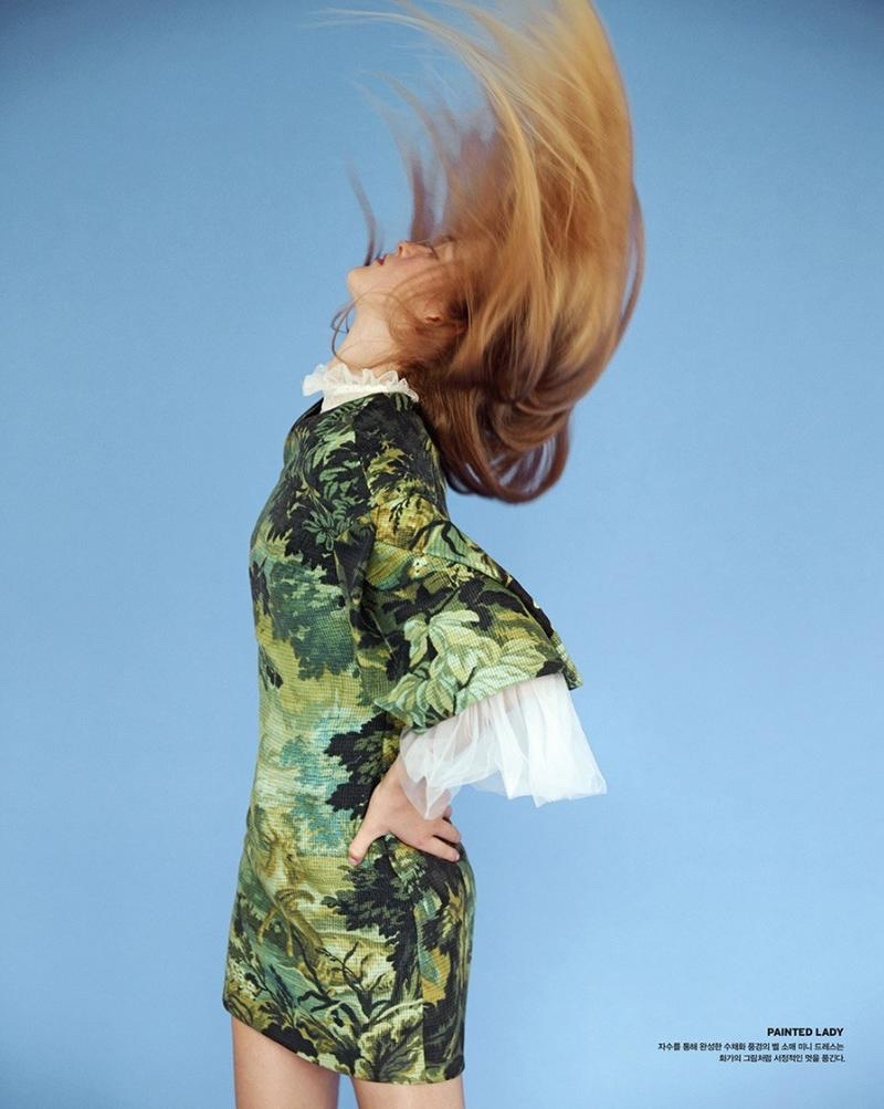 Flipping her hair, Jean Campbell wears printed dress from Burberry with ruffled sleeves