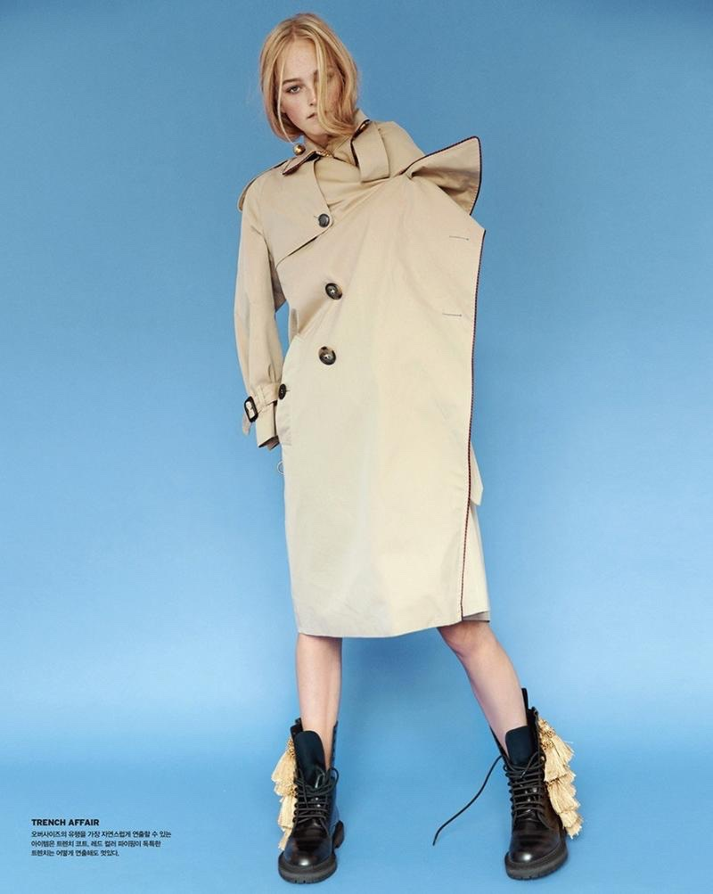 Posing in the studio, Jean Campbell wears Burberry trench coat