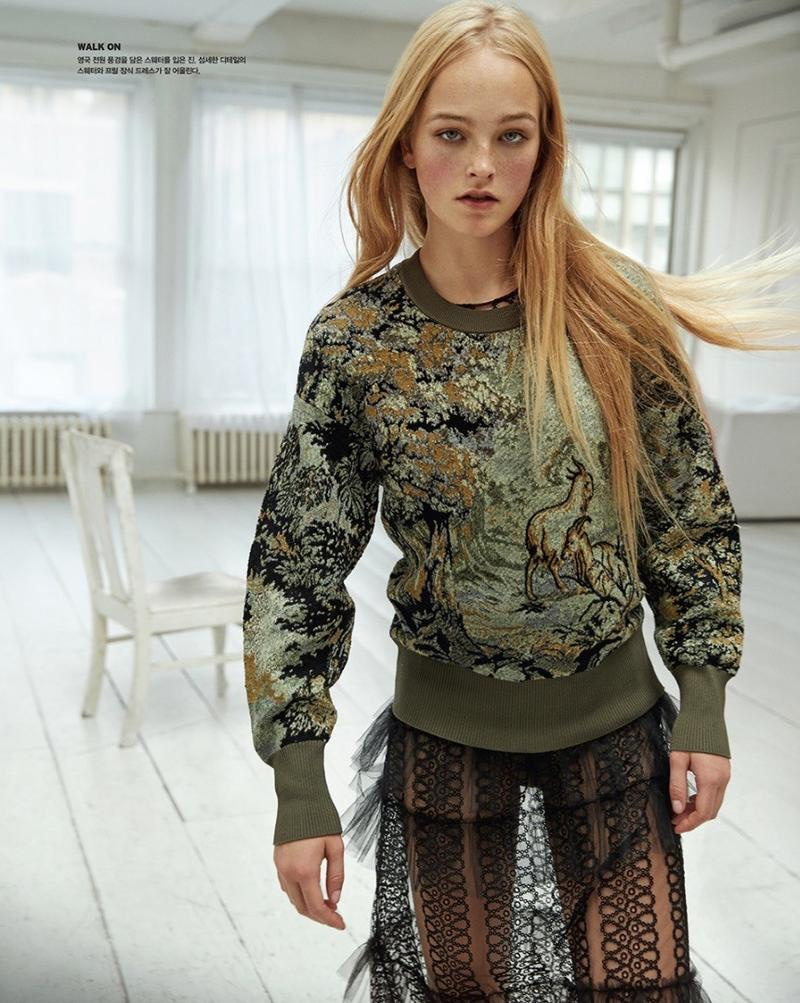 Model Jean Campbell wears Burberry embroidered sweatshirt with sheer skirt