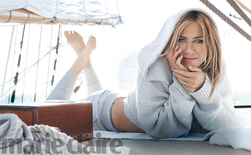 Jennifer Aniston wears Adeam sweater and Vince pants