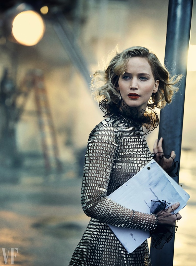 Holding a script, Jennifer Lawrence poses in Valentino Haute Couture gown
