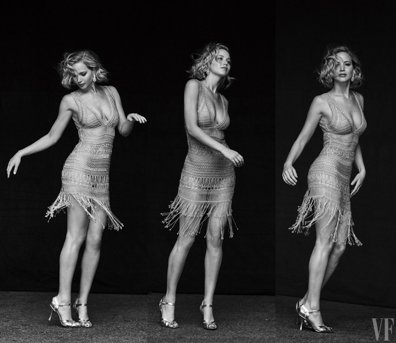 Photographed in black and white, Jennifer Lawrence wears Alberta Ferretti fringed adorned dress