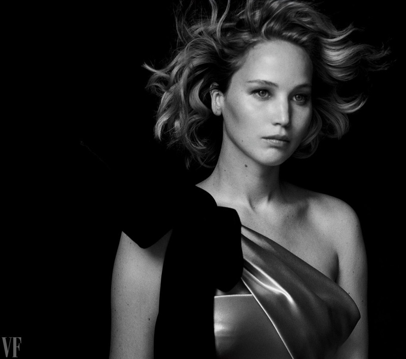 Jennifer Lawrence wears an off-the-shoulder gown from Armani Prive
