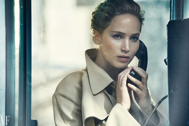 Posing on the phone, Jennifer Lawrence wears Dior trench coat