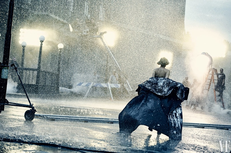 Running in the rain, Jennifer Lawrence poses in Jean Paul Gaultier Haute Couture cape with Dior shoes