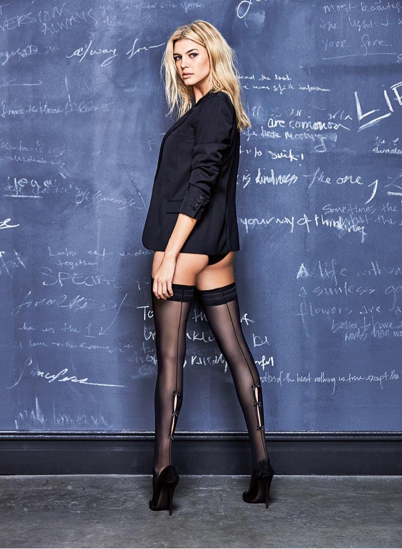 Model Kelly Rohrbach wears Calzedonia blazer with sheer hosiery