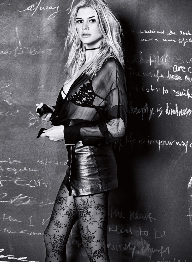 Photographed in black and white, Kelly Rohrbach wears lace bra with leather miniskirt and lace hosiery