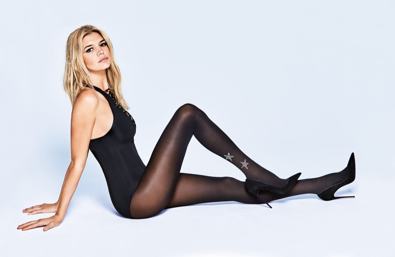Model Kelly Rohrbach poses in black bodysuit and hosiery from Calzedonia