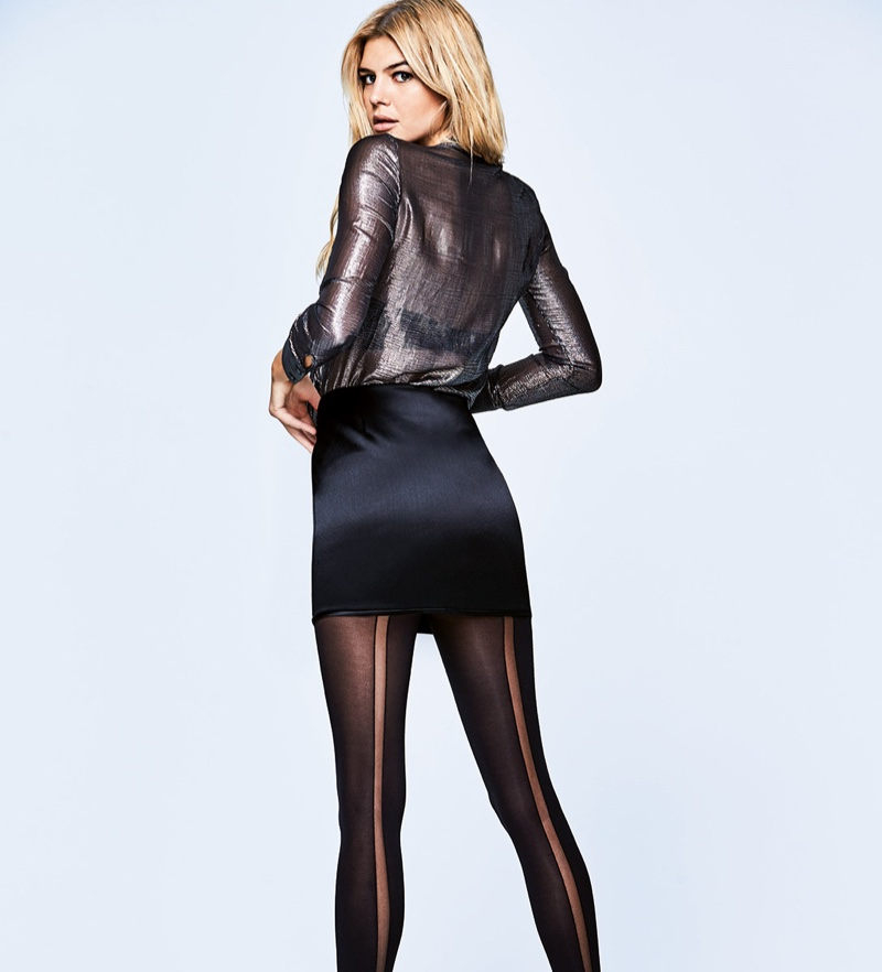 Kelly Rohrbach models sheer shirt with black miniskirt and black hosiery