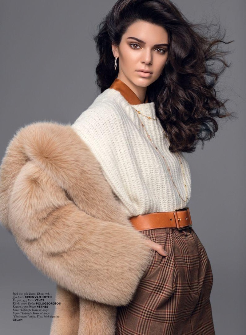 Kendall Jenner models knit sweater, plaid pants and fur jacket