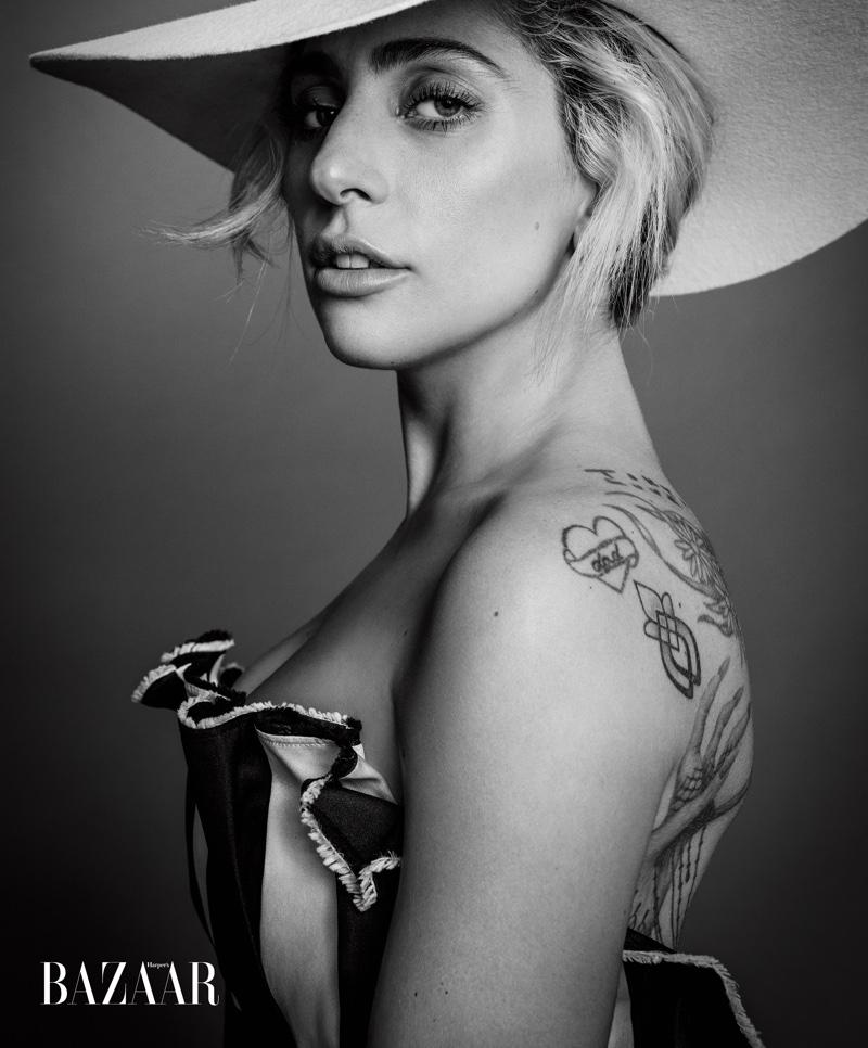 Getting her closeup, Lady Gaga wears Carolina Herrera gown with Gladys Tamez Millinery hat