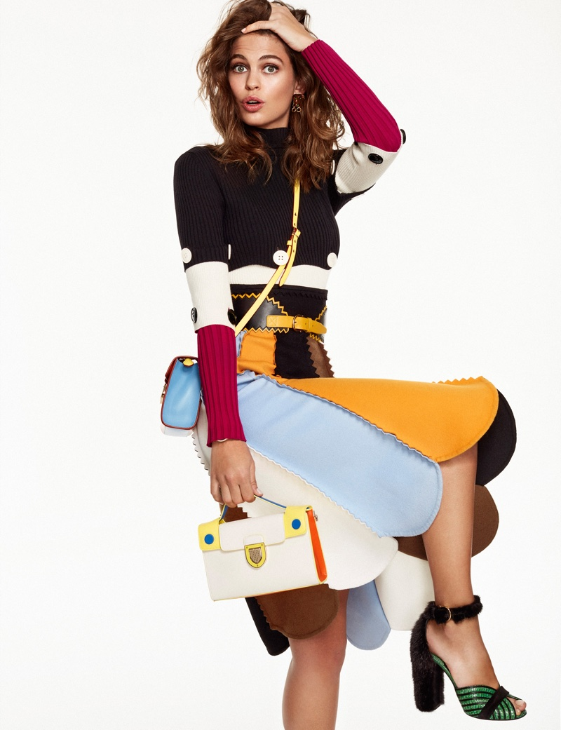 Lauren Auerbach strikes a pose in Salvatore Ferragamo sweater and skirt