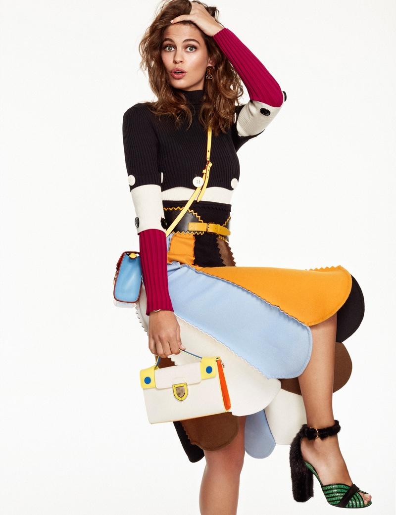 Lauren Auerbach strikes a pose in Salvatore Ferragamo sweater and skirt