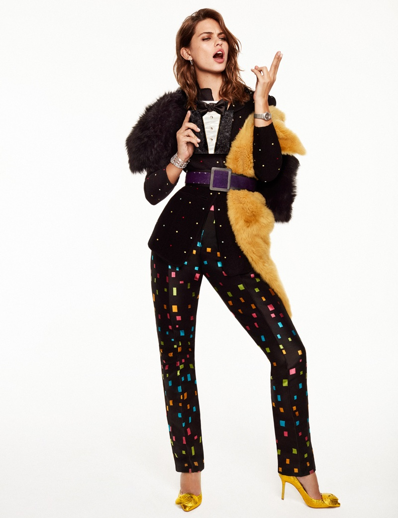 The model suits up in Emporio Armani printed jacket and trousers with gold heels