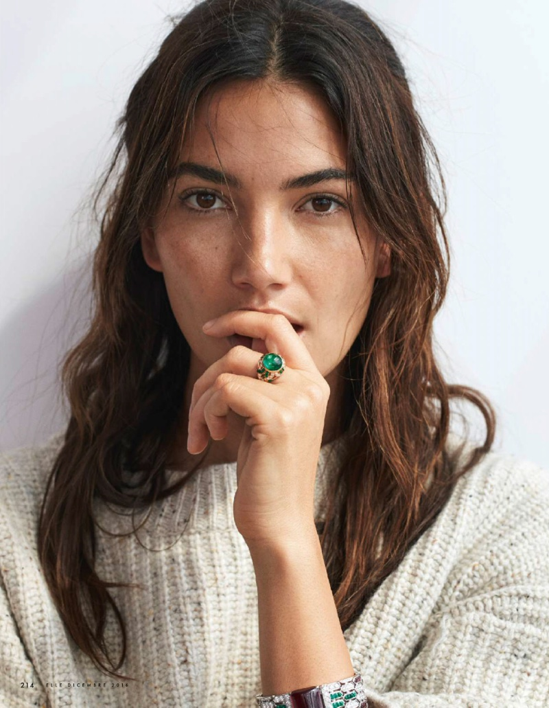 Lily Aldridge poses with Bulgari ring and H&M sweater