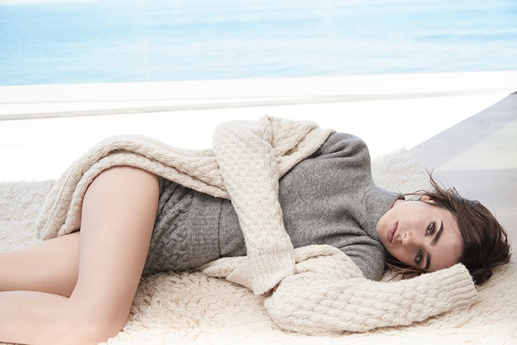 Lounging on a rug, Lily Collins wears Vince cardigan sweater over Blumarine knit