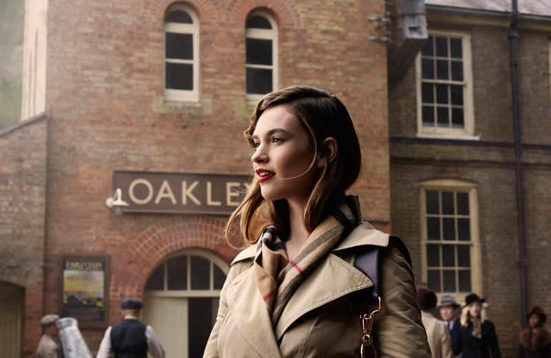 Actress Lily James wears a Burberry trench coat