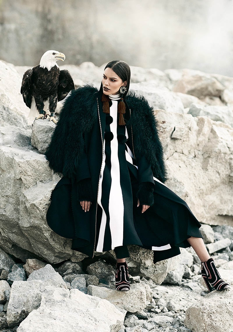 Photographed by Chris Nicholls, the model wears glamorous looks in the outdoors