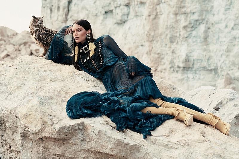 Embracing pleats, Lizzy Salt models Roberto Cavalli dress
