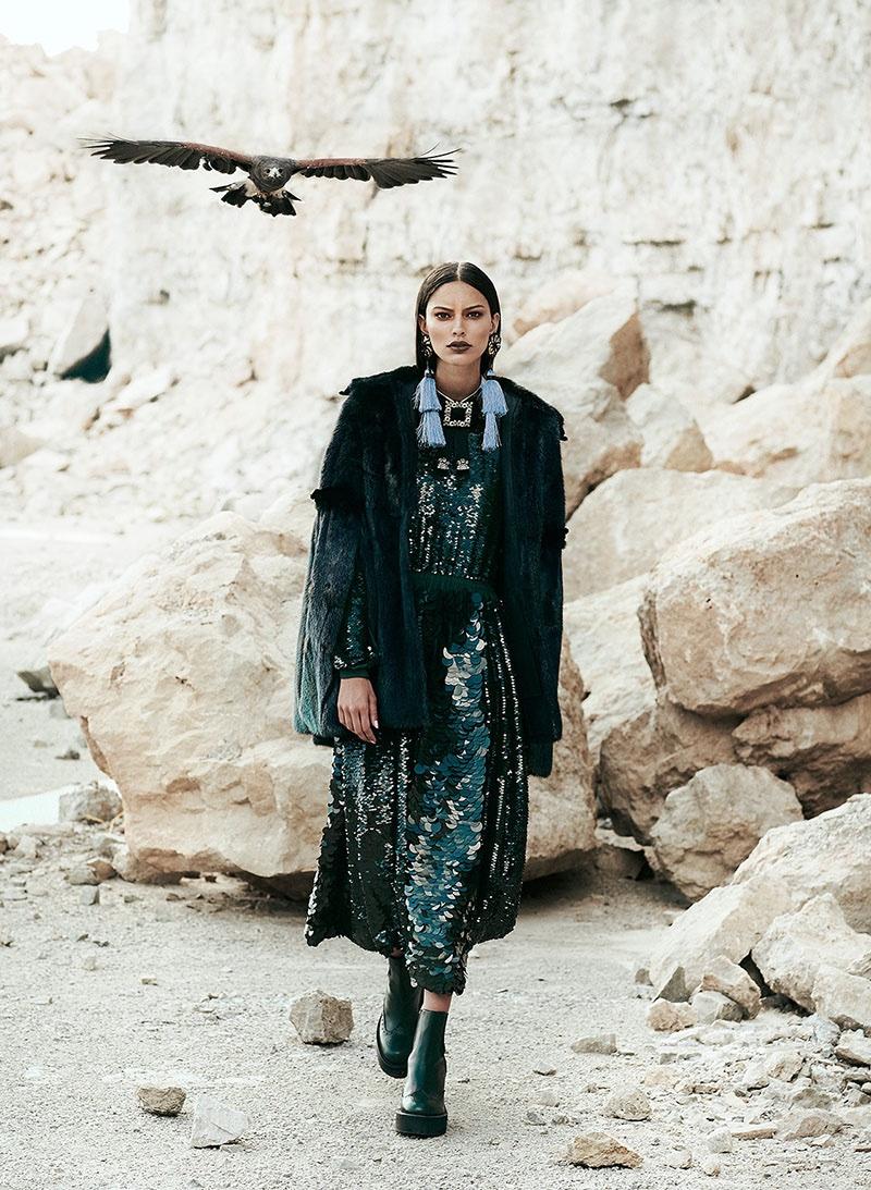 Lizzy Salt models Fendi fur cape, Rochas sequin dress and shoes