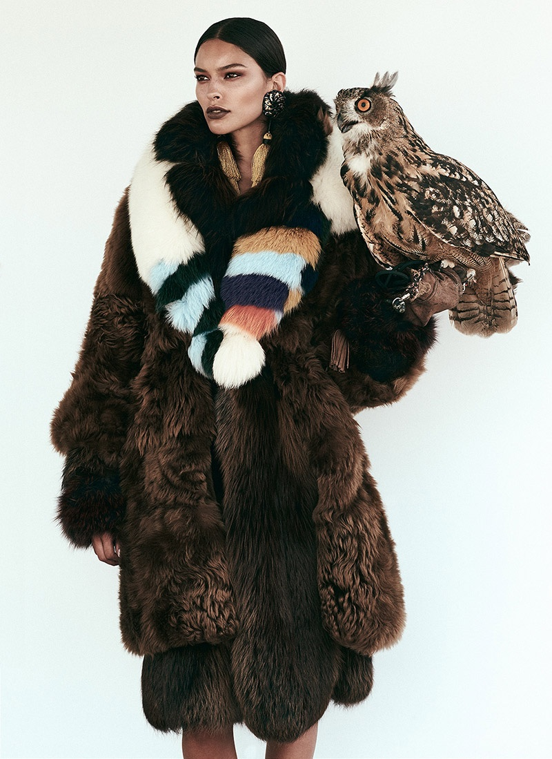 Posing with an owl, the model wears Fendi fur coat and stole with DSquared2 tasseled earrings