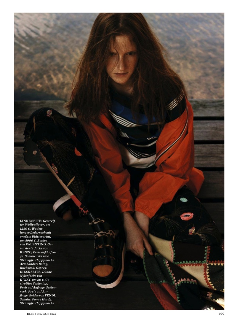 Model Magdalena Jasek poses in K-Way jacket with Fendi striped silk top and skirt with Pierre Hardy shoes