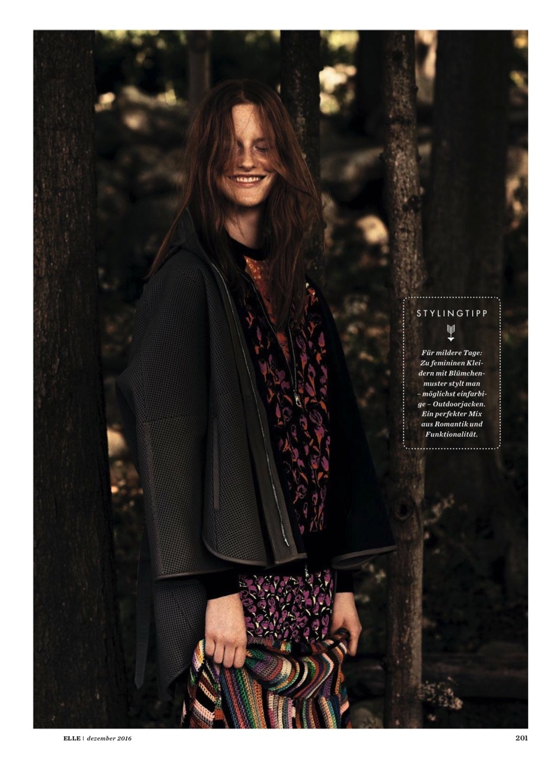 Magdalena Jasek poses in floral print cardigan with printed top by Maison Margiela and leather jacket from Emporio Armani