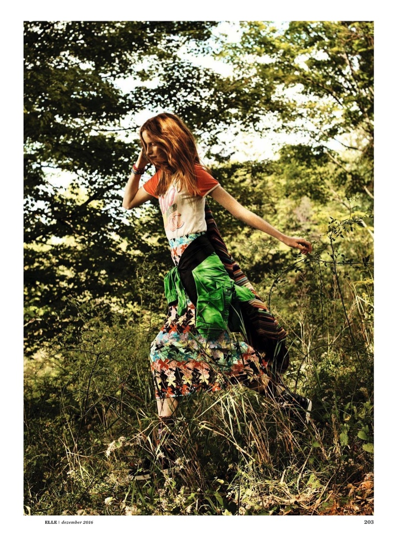 Magdalena Jasek goes for a run in Chanel print t-shirt and lace skirt with embellished jackets from Kenzo