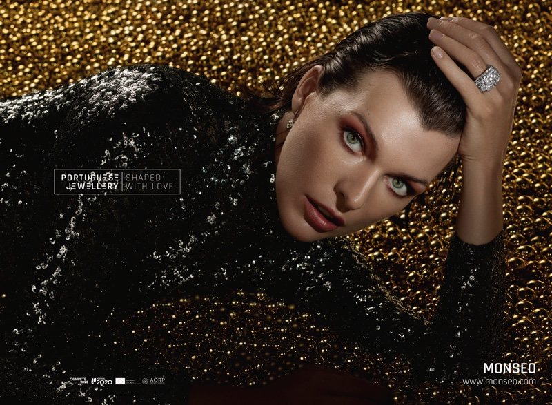 Dripping in sequins, Milla Jovovich wears Monseo earring and ring