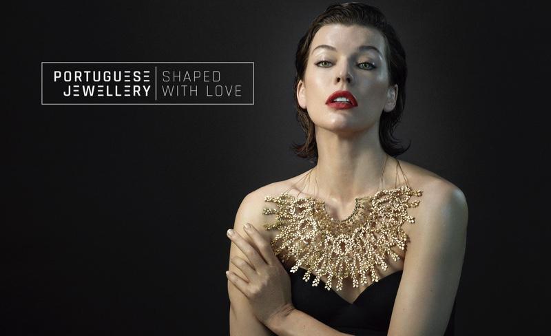 Milla Jovovich wears a gold statement necklace in Portuguese Jewellery campaign