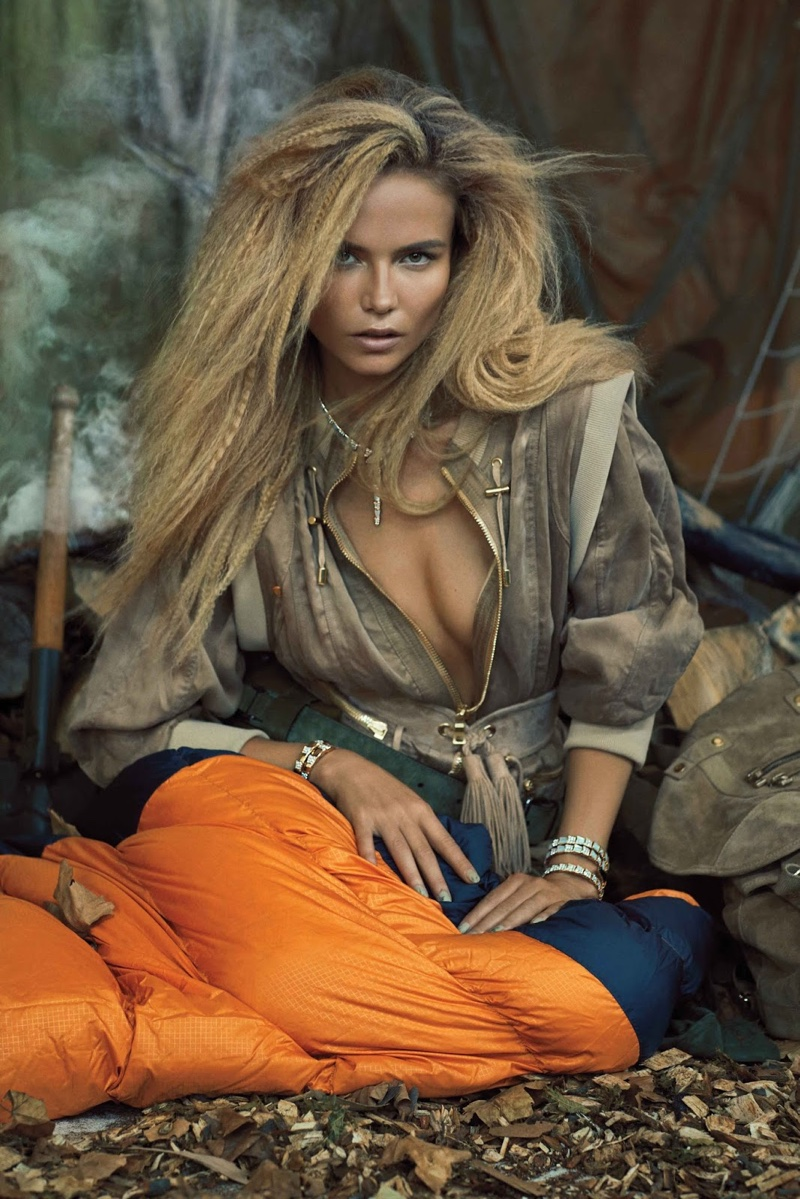 The model poses in glamorous camping looks for the fashion editorial